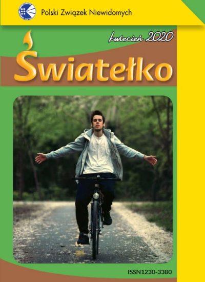 Okładka Światełka - chłopak jedzie na rowerze przez park, ręce ma szeroko rozłożone, przymknięte oczy, rozkoszuje się jazdą