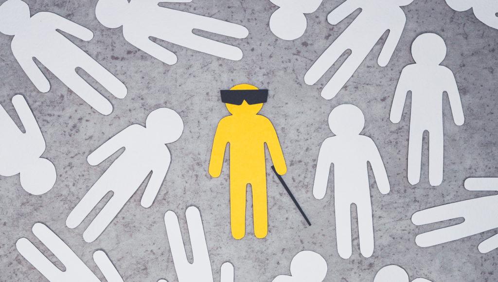 Grafika. Postać osoby niewidomej w centrum, a dookoła inne postacie